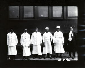 Food service workers standing in front of a car of the Boston and Albany Railroad, Milford, Mass., ca. 1910