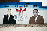 """MLK Jr. mural at West Montana Street and Woodward Avenue, Highland Park, MI, 2009. A local artist said the mural was about """"Three powerful men, three men that changed the world."""""""