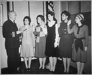 """""""Cmdr. Thomas A. Gaylord, USN (Ret'd), administers oath to five new Navy nurses commissioned in New York..."""""""