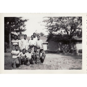 A group of boys pose in front of cabins at Breezy Meadows Camp.