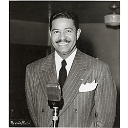 Man in suit at microphone