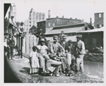 Group of freedmen, including children, gathered by a canal in Richmond, Virginia, in 1865