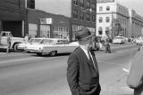 Public safety commissioner Bull Connor speaking to a reporter during the arrest of civil rights demonstrators in downtown Birmingham, Alabama.