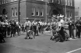 Police officers and fire fighters in the street at the intersection of 17th Street North and 6th Avenue North in Birmingham, Alabama, during the Children's Campaign.