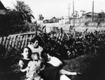 Woman and children in front yard