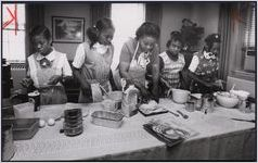 Girl Scouts making bread with Mary Scruggs, Atlanta, Georgia, March 1978.