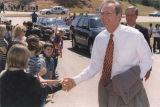 Governor Don Siegelman shaking hands with children.