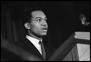 Walter E. Fauntroy speaking at a podium at the Youth, Non-Violence, and Social Change conference, Howard University