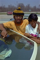 Students Pose for Picture Behind Car