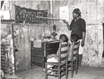 Negro mother teaching children numbers and alphabet in home of sharecropper, Transylvania, Louisiana, January 1939