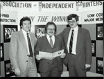 Association of Independent Printers event attendees near a display, Los Angeles, 1986