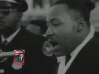 Series of WSB-TV newsfilm clips of Dr. Martin Luther King, Jr. speaking about freedom and the civil rights movement at an outdoor rally held in Atlanta, Georgia, 1963 December 15