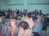A public hearing on candidates for the 1970 elections for Roanoke City Council transpires at the Appalachian Power Company building auditorium in Roanoke, Va.; Mrs. William A. Tingle gives an interview after the meeting