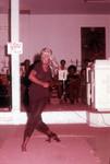 Woman dancing wearing a head scarf