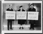 [Elmer Mosee, Daisy Lampkin, and Sidney R. Redmond, full-length portraits, holding signs protesting lynching]