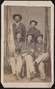 [Five unidentified soldiers of the last Color Guard of the 30th Ohio Infantry Regiment in uniforms with rifles and tattered flags]
