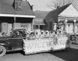 Children from the Williamson School on a Mardi Gras float in an African American neighborhood in Mobile, Alabama.