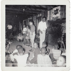 A group of boys gathers for activities in a cabin at Breezy Meadows Camp.