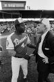 Hank Aaron shaking hands with Mayor George Seibels before a game between the Atlanta Braves and the Baltimore Orioles at Rickwood Field in Birmingham, Alabama.