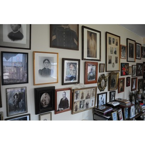 Photographs in the living room of Reverend Chauncy Moore.