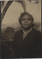 Mississippi State Sovereignty Commission photograph of Mary E. Dantzler dressed in a black dress and wearing pearl earrings and a pearl necklace, Meridian, Mississippi, 1950s
