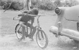 Bobby Bell sitting on a bicycle in Montgomery, Alabama.