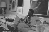 B. B. King: New Haven, Conn. Yale University. B. B. King playing guitar and singing in apartment, seated on sofa (BKP Q-74)