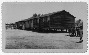 Photograph of African American students in front of wooden school buildings, Manchester, Georgia, 1953