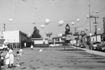 Child Development Center children and adults releasing balloons, Los Angeles, 1987