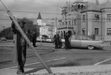 People standing near the Macon County courthouse in Tuskegee, Alabama, observing a student demonstration to protest the murder of Samuel L. Younge, a civil rights worker.