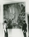 """Artist Aaron Douglas (left) and Schomburg Collection curator Arthur A. Schomburg in front of Douglas's painting """"Aspects of Negro Life: Song of the Towers"""""""