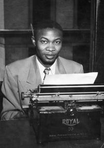 A Suffolk Journal staffer sitting at a typewriter, circa 1950s