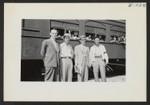 (L. to R.) Robert Allison, Reverend Kai, Paul A. Taylor, Director, Mits Kimura. Taken just before the September 24 segregation train left Jerome for Tule Lake. Photographer: Lynn, Charles R. Dermott, Arkansas