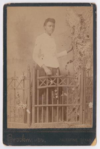 Unknown African American Woman Behind Gate