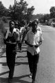 Edward Rudolph leading marchers down a street in Prattville, Alabama, during a demonstration sponsored by the Autauga County Improvement Association.