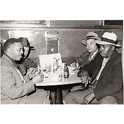 Four men in a restaurant booth