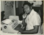 Eugene Redmond at a typewriter