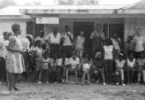 Edward Rudolph and others, standing on the porch of the Autauga County Improvement Association office in Prattville, Alabama, on the day of a civil rights march.