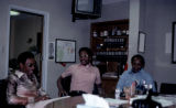 Film transparency of Lonnie Chaney, Reverend Marion D. Bennett, and James Chaney, circa 1975