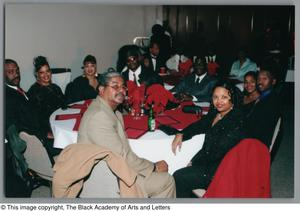 Guests attending the Christmas Kwanzaa soiree Christmas/Kwanzaa Soiree