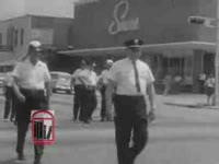 WSB-TV newsfilm clip of a civil rights march and resulting arrest Civil rights preachers and local officials speaking at mass meetings Groups of Albany city officials as well as civil rights leaders entering the federal courthouse And Dr. Martin Luther King, Jr., and Reverend Ralph D. Abernathy at a press conference in Albany, Georgia, 1962 July