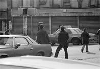 Pedestrians and police officer, Bronx