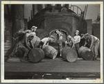 Men moving barrels
