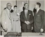 Congratulated: Roy Wilkins, (second from right) is congratulated just after he receives appointment as NAACP executive secretary, succeeding Walter White Left to right: A. Maceo Smith, Dallas, Tex., member of NAACP board of directors; Mrs. Wilkins; Mr. Wilkins; Theodore Berry, member of board and of Cincinnati city council /