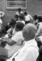 Audience seated in chairs outside a brick church building in Prattville, Alabama, during a meeting of the Autauga County Improvement Association.
