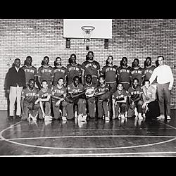 "City champion Fifth Avenue High School Basketball team, including Larry Hawkeye"" Hawkins, Fleming ""Flippy"" Reynolds, Ray Outlaw, L.D. Lawson, James Jackson, and coach George Cupples"""
