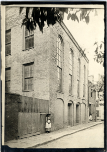 Exterior view of the African Meeting House with a woman standing on the sidewalk, Boston, Mass., ca. 1885