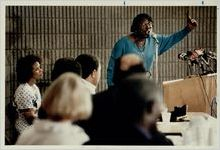 Eva Davis speaks during a panel at the District 5 emergency town hall meeting at A.A. Crim High School, November 17, 1991