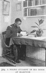 A Negro student in his room at Hampton