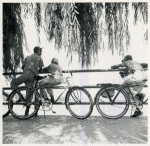 Wartime vacations; Sunday cyclists watching sailboats at Haines Point; Washington, D.C